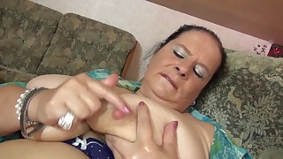 Cute busty mature is sucking her sex toys