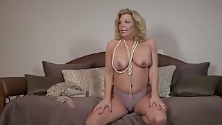 Soloing bbw mature shows off her boobs