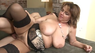 Sensual busty mature sucks a young dick