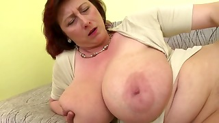 Lusty mature is sucking her lovely dildo