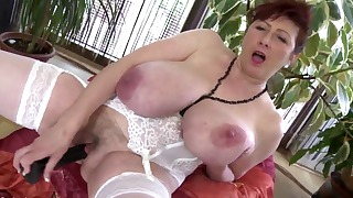 Cute redhead mature opens her wet hole