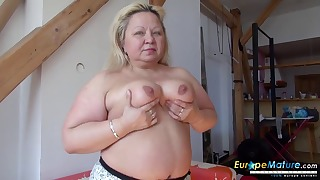 Sweet busty mature shows off her tits
