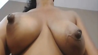 Mature big breasted ebony gets nude