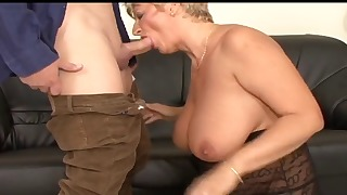 Good-looking blonde gives a hot blowjob