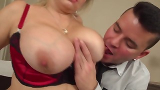 Sensual big-boobed MILF is sitting on the face