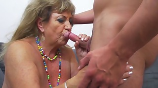 Good-looking mature opens her little pussy