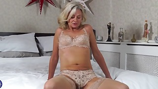 Beautiful blonde with small tits shows her pussy