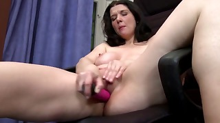 Good-looking busty brunette mature solo