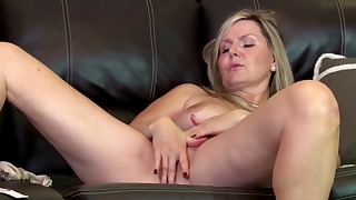 Passionate blonde mature shows her pussy