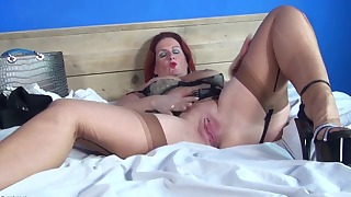 Good-looking redhead mature opens her wet hole