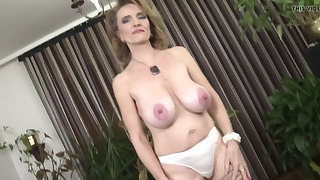 Beautiful busty mature shows her nice body