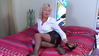 Mature stockings solo in the bedroom