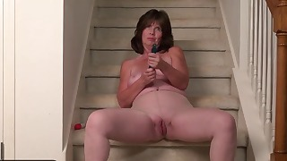 Beautiful brunette granny undresses on cam